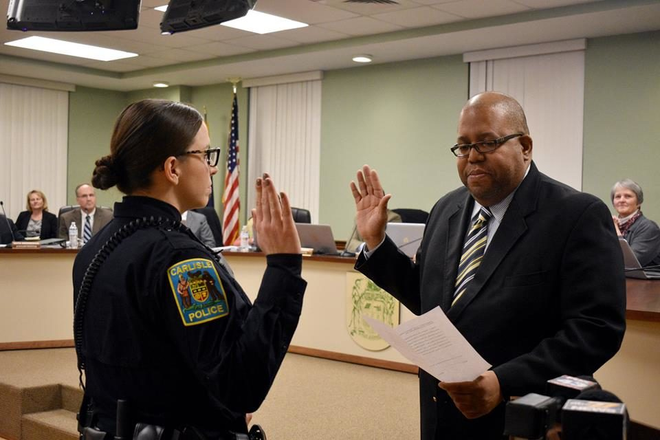 Mayor Scott swears in new officer in Carlisle
