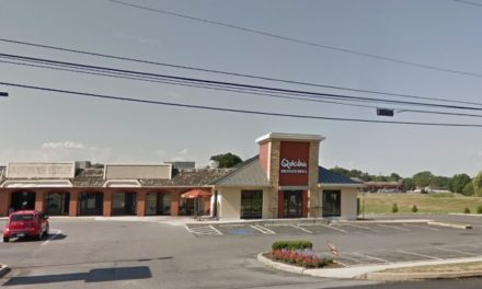Following complaint Lancaster Qdoba at the Shops at Rockdale fails surprise inspection, 8 violations, brownish colored moist residue on the soda dispenser nozzle and ice chute