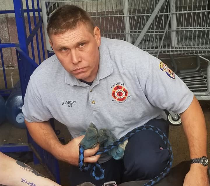 Hazleton Fire Fighters rescue dog from water bottle return at Giant