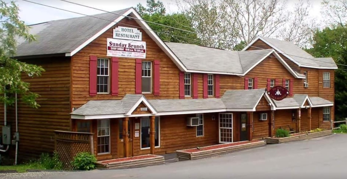 Old food residue on  blade, frame and blade guard of meat slicer, new owners at New Inn at Lackawaxen fail restaurant inspection